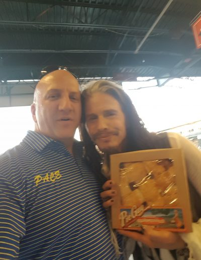 Chris with Steven Tyler holding Pie Guys